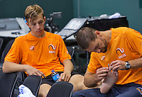 Switserland, Genève, September 16, 2015, Tennis,   Davis Cup, Switserland-Netherlands, Practise Dutch team,  fysio Edwin Visser treating Tallon Griekspoor for a blister<br /> Photo: Tennisimages/Henk Koster