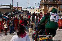 Ross Adam leaves the finish chute in Nome during the 2010 Iditarod