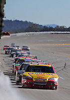 Nov. 1, 2009; Talladega, AL, USA; NASCAR Sprint Cup Series driver Kevin Harvick leads the field down the backstretch during the Amp Energy 500 at the Talladega Superspeedway. Mandatory Credit: Mark J. Rebilas-