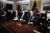 "On January 18, 1991, United States President George H.W. Bush with his staff of civilian and military leaders, gathered in the ""tank"", the conference room of the Joint Chiefs of Staff in the Pentagon, for briefings and discussions concerning Operation Desert Storm.  From left to right: John H. Sununu, White House Chief of Staff; Brent Scowcroft, Assistant to the President for National Security Affairs; Honorable Dick Cheney, Secretary of Defense; President Bush; General Colin L. Powell, Chairman, Joint Chiefs of Staff; and Admiral David E. Jeremiah, Vice Chairman, Joint Chiefs of Staff.<br /> Mandatory Credit: Helene Stikkel / DoD via CNP"