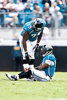 October 18, 2009:       Jacksonville Jaguars offensive tackle Eugene Monroe (75) lends a helping hand to David Garrard (9) after Garrard was sacked during action between the NFC West St. Louis Rams and AFC South Jacksonville Jaguars at Jacksonville Municipal Stadium in Jacksonville, Florida. Jacksonville defeated St. Louis in overtime 23-20............