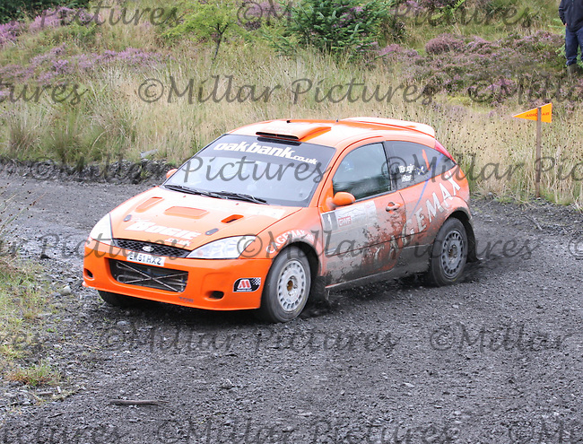 David Bogie - Kevin Rae at Junction 3 on Special Stage 4 J & B Print Arroch Hill of the GWF Energy Merrick Stages Rally 2013, Round 7 of the RAC MSA Scotish Rally Championship which was organised by Machars Car Club and Scottish Sporting Car Club and based in Wigtown on 7.9.13.