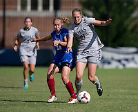 Mary Kroening (21) of Georgetown fights for the ball with Ashleigh Goddard (23) of DePaul during the game at Shaw Field on the campus of Georgetown University in Washington, DC.  Georgetown tied DePaul, 1-1, in double overtime.