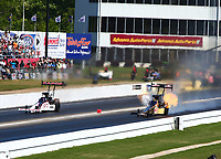 May 7, 2017; Commerce, GA, USA; NHRA top fuel driver Steve Torrence (left) races alongside Leah Pritchett during the Southern Nationals at Atlanta Dragway. Mandatory Credit: Mark J. Rebilas-USA TODAY Sports