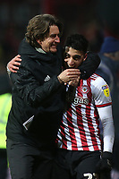 Brentford Manager, Thomas Frank, celebrates their 1-0 victory with Said Benrahma at the final whistle during Brentford vs Aston Villa, Sky Bet EFL Championship Football at Griffin Park on 13th February 2019