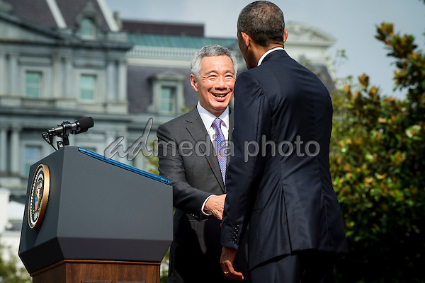 Prime Minister Lee Hsien Loong of Singapore and United States President Barack Obama shake hands during official welcoming ceremonies on the South Lawn of the White House in Washington, DC on August 2, 2016. Lee is on a State Visit to the United States. Photo Credit: Pete Marovich/CNP/AdMedia