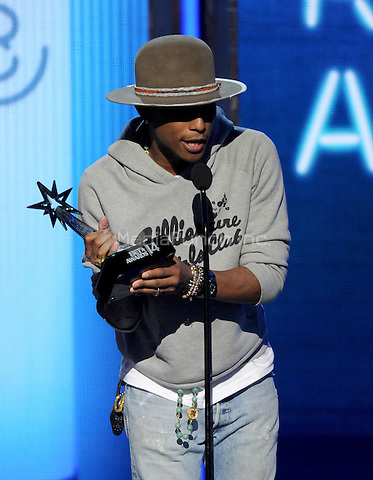 LOS ANGELES, CA - JUNE 29 : Pharrell Williams accepts the Best Male R&B/Pop Artist award onstage at the BET Awards '14 at Nokia Theatre L.A. Live on June 29, 2014 in Los Angeles, California. Credit: PGMicelotta/MediaPunch