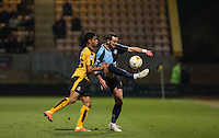 Paul Hayes of Wycombe Wanderers controls the ball under pressure from Darnell Furlong of Cambridge United during the Sky Bet League 2 match between Cambridge United and Wycombe Wanderers at the R Costings Abbey Stadium, Cambridge, England on 1 March 2016. Photo by Andy Rowland / PRiME Media Images.