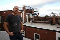 (171119RREI1932)  Adilson, a former esquinero, on his apartment roof near La Esquina where Latinos have gathered for decades at the corner of Mt. Pleasant St. and Kenyon St. NW. to play chekers (damas). Washington DC.  Nov. 19 ,2017 . ©  Rick Reinhard  2017     email   rick@rickreinhard.com