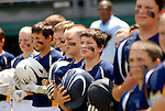 Players during the National Anthem at a Little League game.