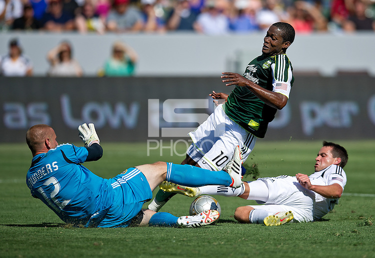 CARSON, CA - June 17, 2012: LA Galaxy goalie Josh Saunders (12) and defender Todd Dunivant (2) prevent a goal scoring run by Portland Timbers forward Danny Mwanga (10) during the LA Galaxy vs Portland Timbers match at the Home Depot Center in Carson, California. Final score LA Galaxy 1, Portland Timbers 0.