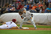 Wisconsin Timber Rattlers first baseman Alan Sharkey (18) waits for a pickoff attempt throw as Paul DeJong (7) dives back to first during a game against the Peoria Chiefs on August 21, 2015 at Dozer Park in Peoria, Illinois.  Wisconsin defeated Peoria 2-1.  (Mike Janes/Four Seam Images)