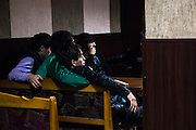Visitors of a semi-underground blues cafe in downtown Grozny watch a football game. Grozny, Chechnya, Russia, 2012