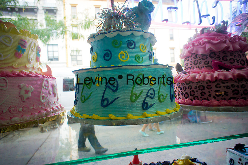 A selection of cakes are seen in an Hispanic bakery in the East Harlem neighborhood of New York on Monday, September 3, 2012. (© Richard B. Levine)