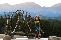 Beau Williams, 14, of Dallas, mimics a bronze ststue at the YMCA of the Rockies Estes Park Center on the edge of Rocky Mountain National Park. The 100-year-old center is one of the gems of the YMCA system. (Kevin Moloney for the New York Times)