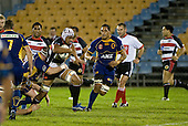 Fritz Lee charges through the tackle of Ben Nolan. Air New Zealand Cup rugby game played at Mt Smart Stadium, Auckland, between Counties Manukau Steelers & Otago on Thursday August 21st 2008..Otago won 22 - 8 after leading 12 - 8 at halftime.