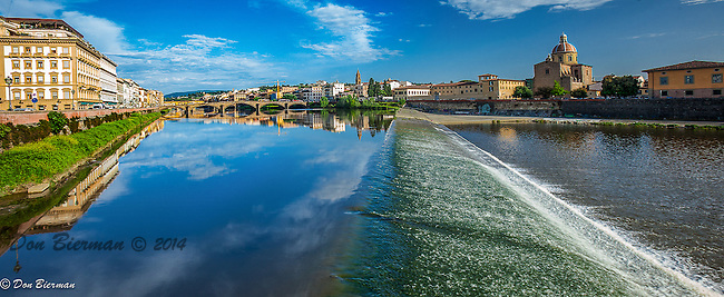 Water flowing over spillway in the Arno River in Florence, Italy.
