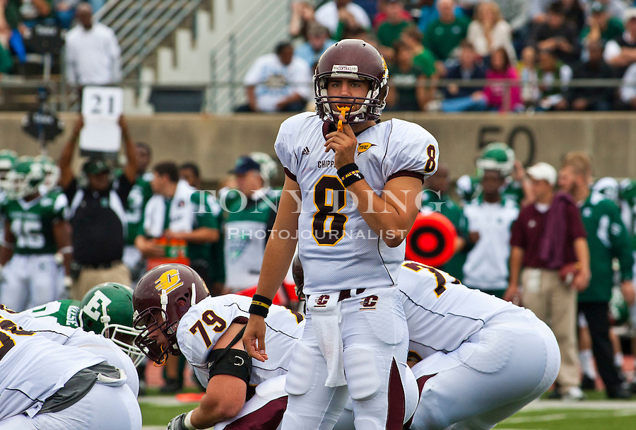 Central Michigan quarterback Ryan Radcliff (8) looks to his sideline for a playcall in the second quarter of an NCAA college football game with Eastern Michigan, Saturday, Sept. 18, 2010, in Ypsilanti, Mich. (AP Photo/Tony Ding)
