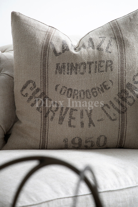 White cushion with print