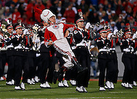The Ohio State drum major leads the band onto the field prior to the the NCAA football game against Penn State at Ohio Stadium in Columbus on Oct. 26, 2013. (Adam Cairns / The Columbus Dispatch)