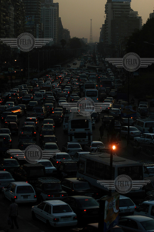 Rush hour traffic at dusk in central Cairo.