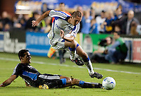 Davy Arnaud (right) tries to avoid Andre Luiz (left) slide tackle. The San Jose Earthquakes defeated the Kansas City Wizards in stoppage time 1-0 at Buck Shaw Stadium in Santa Clara, California on August 22, 2009.