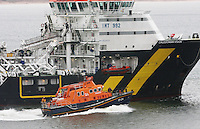 Oil Supply ship Caledonian Vision is overtaken by the Royal National Lifeboat Institute Lifeboat Bon Accord as it leaves Aberdeen Harbour.