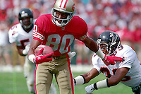 SAN FRANCISCO, CA - Jerry Rice of the San Francisco 49ers runs with the football during a game against the Los Angeles Rams at Candlestick Park in San Francisco, California in 1992. Photo by Brad Mangin