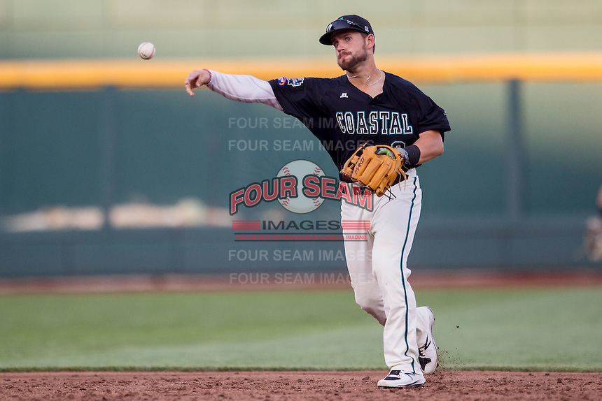 Coastal Carolina Chanticleers second baseman Tyler Chadwick (8) makes a throw to first base against the Florida Gators in Game 4 of the NCAA College World Series on June 19, 2016 at TD Ameritrade Park in Omaha, Nebraska. Coastal Carolina defeated Florida 2-1. (Andrew Woolley/Four Seam Images)