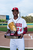 Indianapolis Indians third baseman Ke'Bryan Hayes (24) holds his 2018 Rawlings Gold Glove Award before an International League game against the Columbus Clippers at Victory Field on April 29, 2019 in Indianapolis, Indiana. (Zachary Lucy/Four Seam Images)