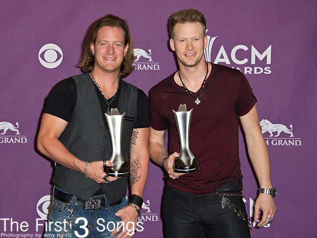 Tyler Hubbard and Brian Kelley of Florida Georgia Line, winners of New Artist of the Year, during the 48th Annual Academy of Country Music Awards at the MGM Grand Garden Arena on April 7, 2013 in Las Vegas, Nevada.