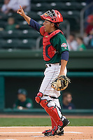 Catcher Luis Exposito (23) of the Greenville Drive let's his defense know there is one out versus the Kannapolis Intimidators at Fluor Field in Greenville, SC, Sunday, April 6, 2008.
