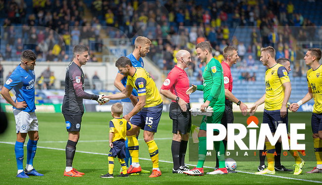 John Mousinho (who makes his 500th senior appearance) of Oxford United shakes hands with Goalkeeper Christy Pym of Peterborough United pre match during the Sky Bet League 1 match between Oxford United and Peterborough at the Kassam Stadium, Oxford, England on 10 August 2019. Photo by Andy Rowland.