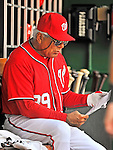 10 July 2011: Washington Nationals Bench Coach Pat Corrales looks over some charts during a game against the Colorado Rockies at Nationals Park in Washington, District of Columbia. The Nationals shut out the visiting Rockies 2-0 salvaging the last game their 3-game series at home prior to the All-Star break. Mandatory Credit: Ed Wolfstein Photo