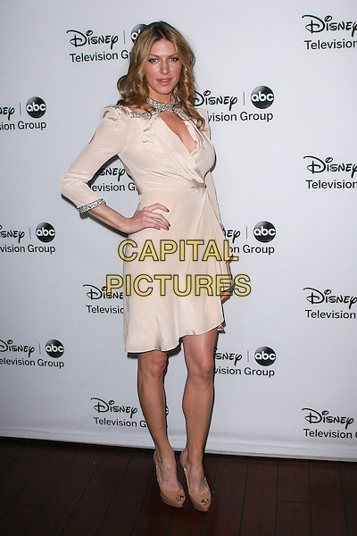 Jes Macallan.Disney ABC Television Group Hosts ?TCA Winter Press Tour? held at Langham Huntington Hotel, Pasadena, California, USA, 11th January 2013..full length beige nude wrap dress ruffle hand on hip .CAP/ADM/AM.©Amelie Mucci/AdMedia/Capital Pictures.