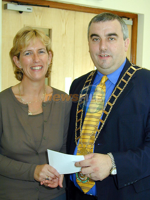 Mayor of Drogheda, Cllr. Sean Collins presenting a cheque to Anne Tracey, Chairperson Fundraising Committee to start the fund  for the new Village of Disabilty in Fair Street..Picture Paul Mohan Newsfile
