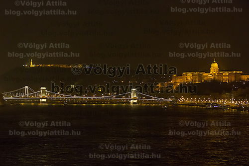 Photo of the Chain Bridge and the Royal Castle during the Earth Hour in Budapest, Hungary on March 23, 2013. ATTILA VOLGYI