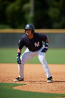 New York Yankees Stanley Rosario (24) leads off first base during a Florida Instructional League game against the Philadelphia Phillies on October 11, 2018 at Yankee Complex in Tampa, Florida.  (Mike Janes/Four Seam Images)