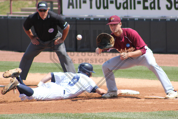 APPLETON - MAY 2011: Jordan Grilliot (9) of the Marietta Pioneers dives safely back to first base during a NCAA Division III Baseball Championship game on May 27, 2011 at Fox Cities Stadium in Appleton, Wisconsin. (Photo by Brad Krause) ....