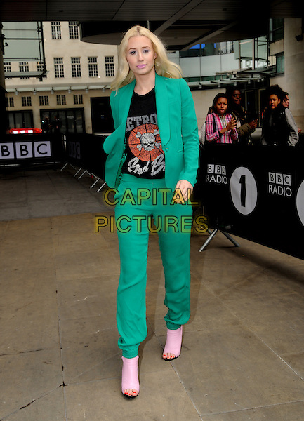 Iggy Azalea<br /> At BBC Radio 1, London, England.<br /> May 31st, 2013<br /> full length green suit black top print pink open toe boots <br /> CAP/AOU<br /> &copy;AOU/Capital Pictures