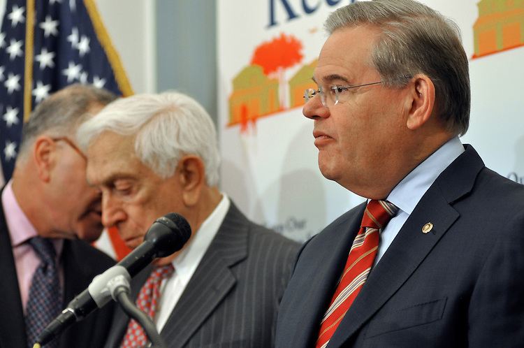 """Sen. Robert Menendez speaks during a news conference on a proposed amendment by Sen. John Thune, R-N.D., that would """"allow people, including some criminals and mentally ill individuals, to carry concealed weapons across state lines"""" in the Capitol Building. Tuesday, July 21, 2009"""
