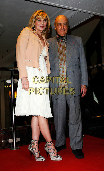 KIM CATTRALL & MOHAMMED AL FAYED.Harrods Summer Sale, Knightsbridge, London, England. .June 30th, 2008 .full length pink peach cream beige jacket grey gray suit white dress lacy strappy sandals shoes .CAP/CAN.©Can Nguyen/Capital Pictures.