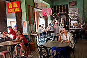 Customers sit in an old Penang kopitiam (coffee shop) in the UNESCO heritage city of Georgetown in Penang, Malaysia. Photo: Sanjit Das/Panos