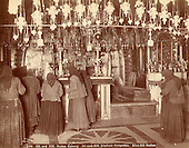 View of the Calvary in the Church of the Holy Sepulchre, c. 1900. Russian pilgrims lighting candles.