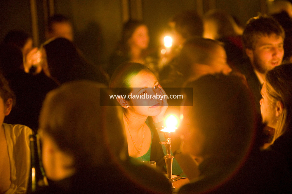 Students have dinner in the formal dinning hall at Magdalene College in Cambridge, United Kingdom, 11 March 2007.
