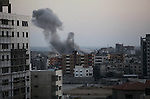 Smoke rises after Israeli air strikes in Gaza City, 20 August 2014. Israeli forces and Palestinian militants in the Gaza Strip exchanged fire 20 August after a ceasefire broke down and negotiators failed to agree on a longer-term truce. At least 21 Palestinians, including several children, were killed and 120 injured, the Palestinian Health Ministry said. Israel's security cabinet was meeting in Tel Aviv to discuss the next steps. Photo by Ashraf Amra