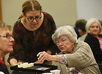 """NWA Democrat-Gazette/FLIP PUTTHOFF <br /> TASTE TESTERS<br /> Lesley Knieriem (cq) with the Rogers Public Library serves samples of olive oil on Tuesday Jan. 8 2019 to library patrons including Arline Ryan (right) of Rogers during a Lunch and Learn program at the library. Troy Johnson with Fresh Harvest in downtown Rogers and Eureka Springs provided samples of olive oils and vinegars for patrons to try and explained the uses of each. Lunch and learn is held from noon to 1 p.m. on the second Tuesday of each month at the library community room. The next program on Feb. 12 will preview the exhibit, """"Men of Steel, Women of Wonder,"""" coming to Crystal Bridges Museum of American Art. Alejo Benedetti, assistant curator, is the presenter. Friends of the Rogers Public Library sponsors Lunch and Learn."""