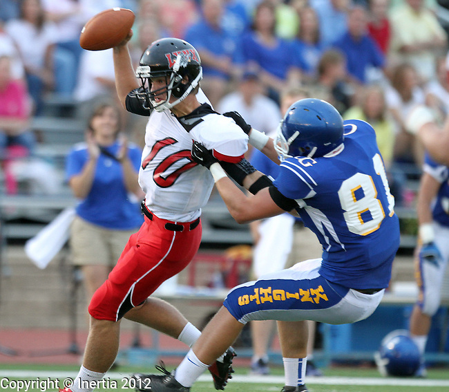SIOUX FALLS, SD - AUGUST 24:  Chase Marso #10 from Brandon Valley is dragged down by Austin Pharis #81 from O'Gorman Friday night in the second quarter of their game at O'Gorman during the season opener for class 11AA football.  (Photo by Dave Eggen/Inertia)