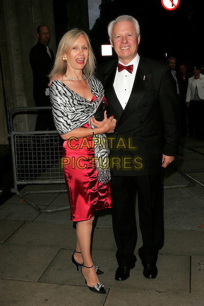 SILVANO GIRALDIN & GUEST.The London Restaurant Awards 2008, Grosvenor House, London, England..September 1st, 2008.full length black tuxedo red dress grey gray wrap shawl silver zebra animal print .CAP/AH.©Adam Houghton/Capital Pictures.