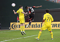 WASHINGTON, DC - OCTOBER 20, 2012:  Lionard Pajoy (26) of D.C United heads past Danny O'Rourke (5) of the Columbus Crew during an MLS match at RFK Stadium in Washington D.C. on October 20. D.C United won 3-2.